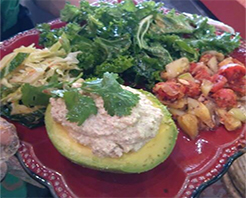 Jerk Nutmeat stuffed avocado, kale salad, pickliz, tomato mango salad.